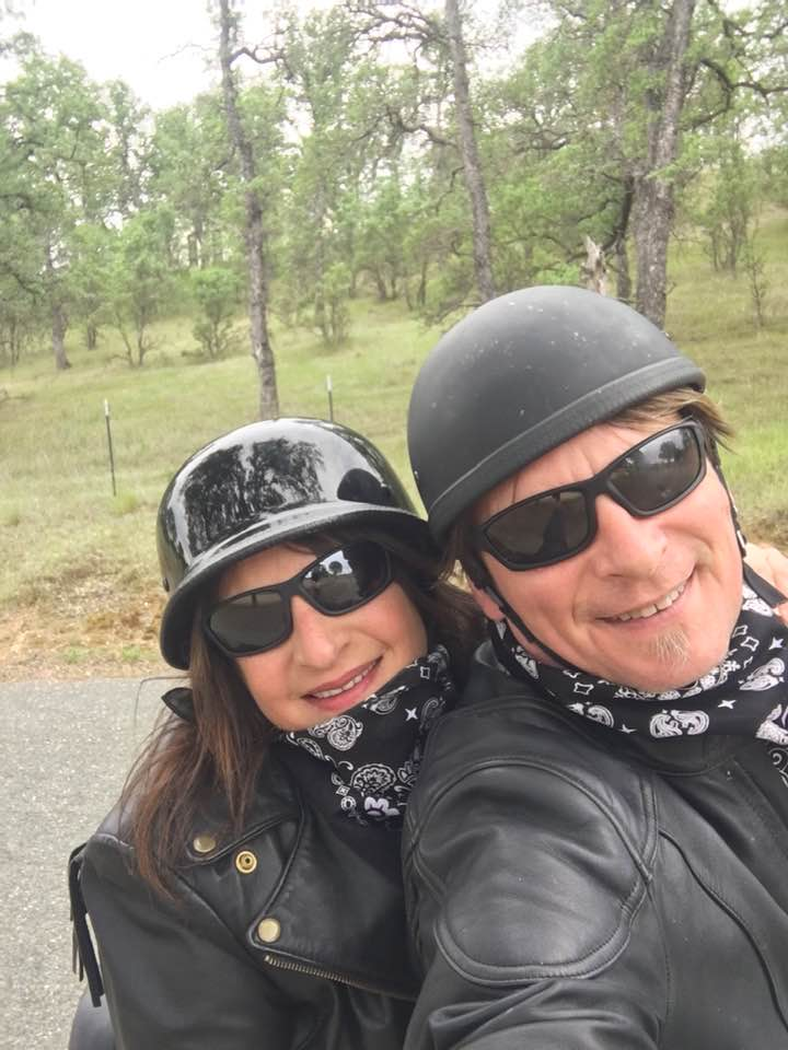 Mandy Feder-Sawyer and her husband, Larry, take a selfie wearing motorcycle helmets on a ride.
