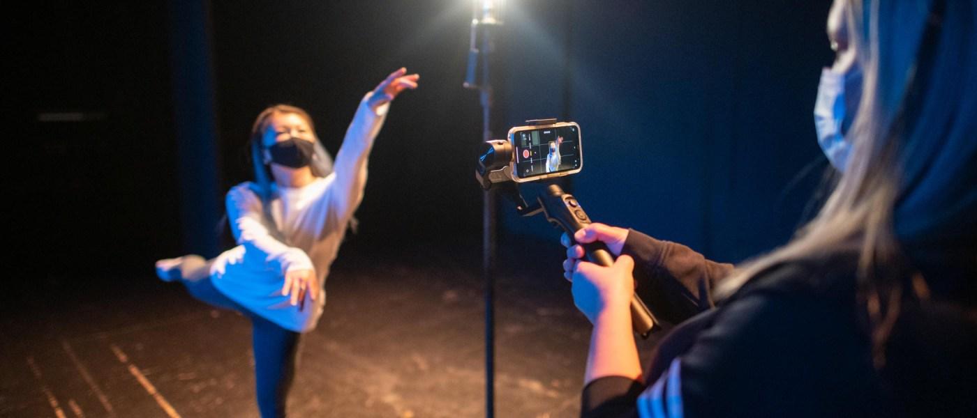 Natsumi Kawamura performs a dance routine as Megan Glynn Zollinger films on an iPhone.