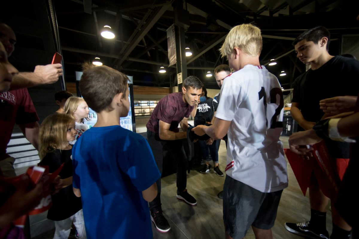 Chris Wondolowski signs autographs for fans who made the trip from Chico to San Jose.