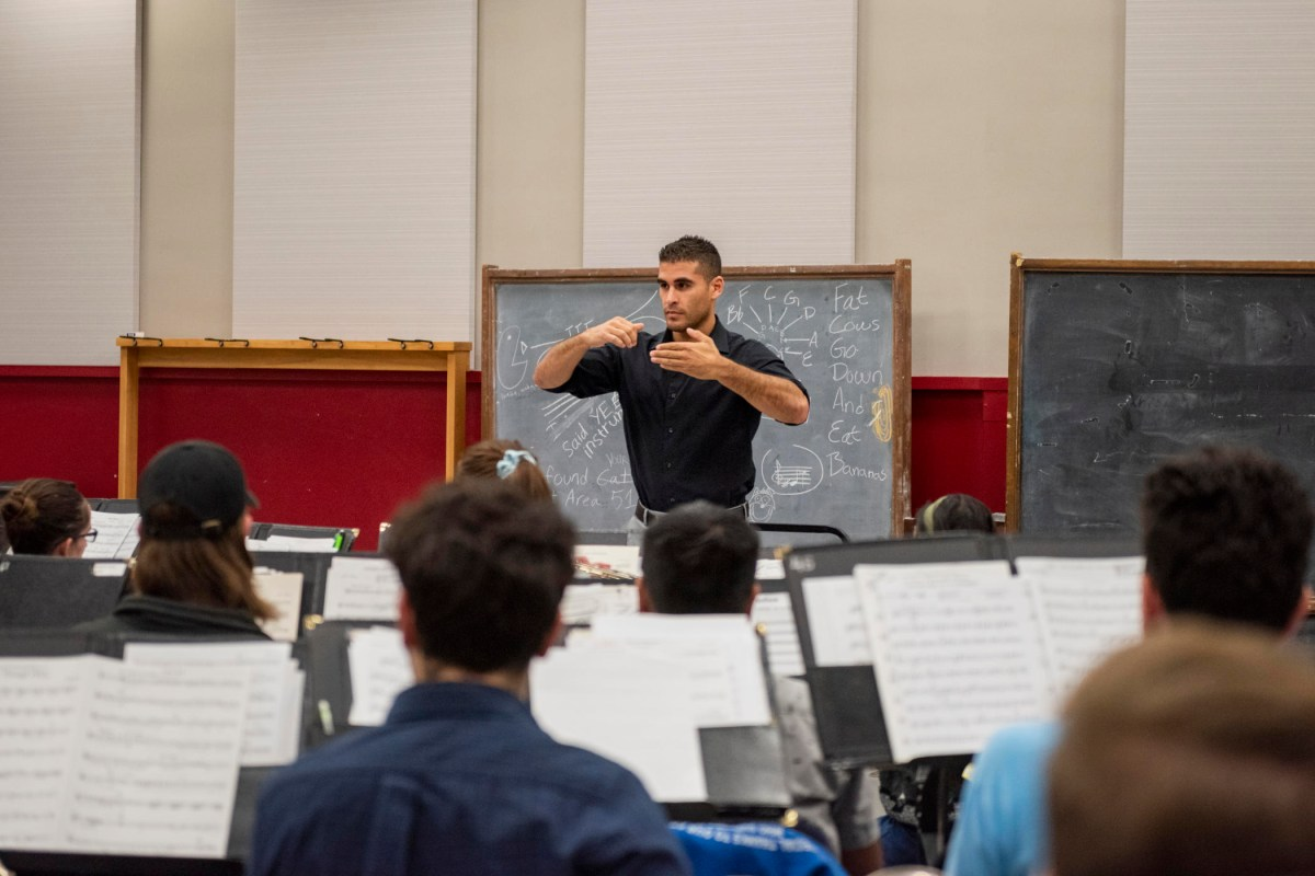 Chris Navarrete conducts a rehearsal in front of seated students