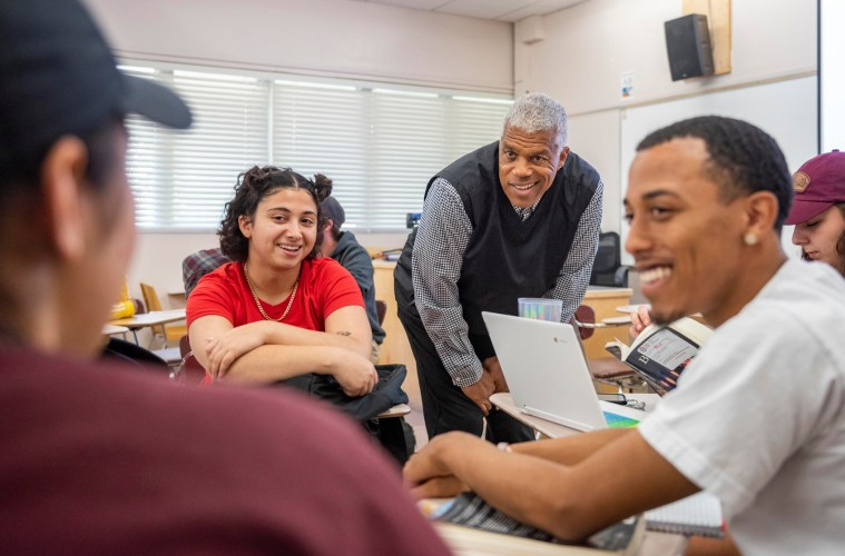 """Vern Andrews conversing with students in his """"Hip-Hop Culture"""" class fall 2019."""