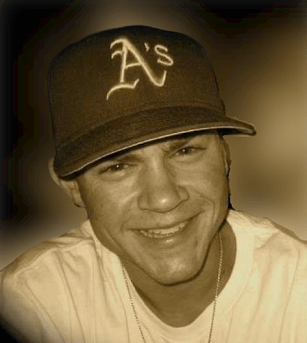 Portrait of Andrew Mora in an A's baseball cap