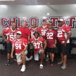 Members of the Chico State football team pose together at a reunion.