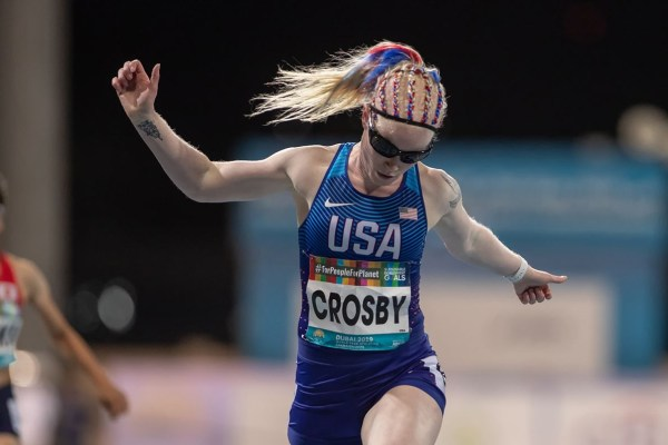Kym Crosby crosses a finish link on a track
