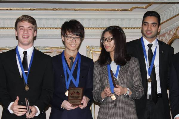 Two Shoreline students, Chronos Chow (middle left) and Shulang Yue (middle right) win honors at DECA's 2016 Pacific Northwest Career Development Conference held Feb. 18-20 in Spokane, WA.