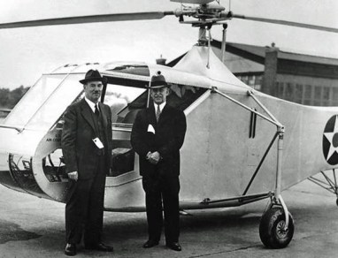 Igor Sikorsky and Orville Wright standing in front of a XR-4 helicopter in 1942.