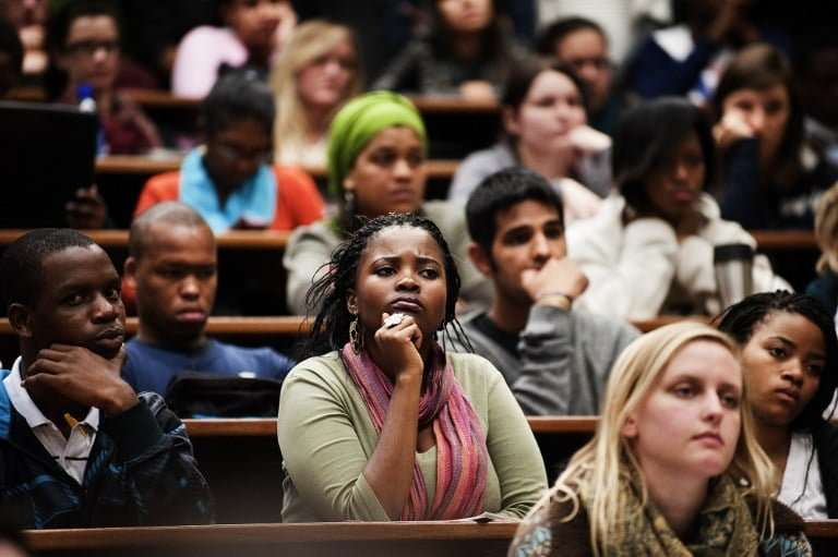 Students from the University of Cape Town listen to Western Cape premier Helen Zille during a meeting at the university in May 2011. Photo: AFP/GIANLUIGI GUERCIA