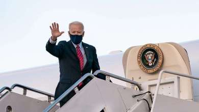 President Joe Biden waves as he boards Air Force One at Joint Base Andrews