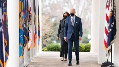President Joe Biden and Vice President Kamala Harris walk from the Oval Office of the White House Friday