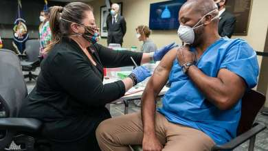 Nurse vaccinator Denise Boehm administers a COVID-19 vaccine to U.S. Army Staff Sgt. Marvin Cornish during a briefing on the vaccine process with President Joe Biden Monday