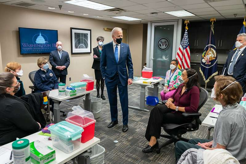 President Joe Biden talks to Veterans and VA staff members during a briefing on the vaccine process Monday