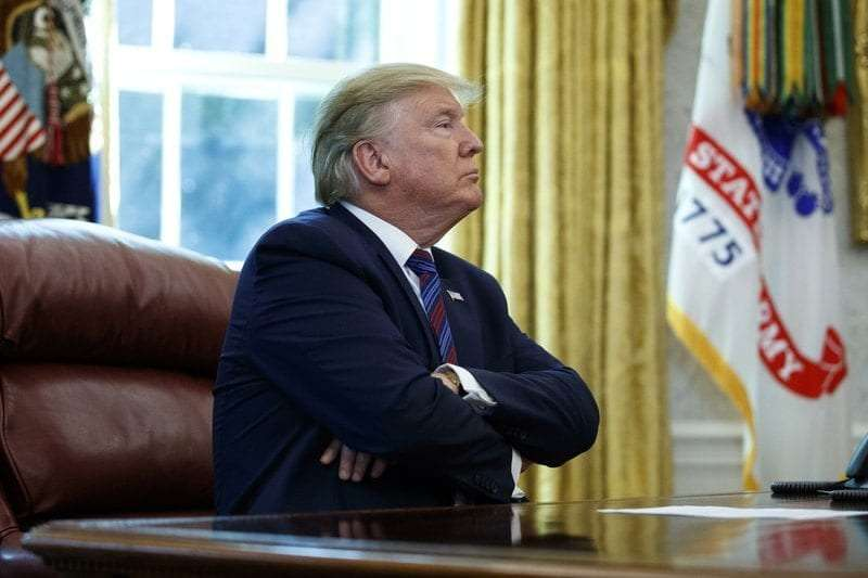 President Donald Trump pauses as he speaks in the Oval Office of the White House in Washington