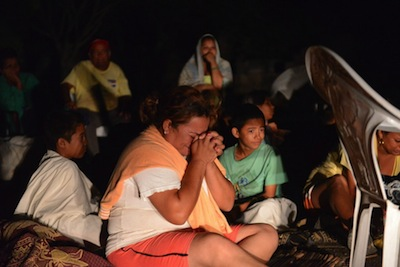 A woman in Nagarote prays after Thursday's earthquake