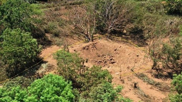 A photo provided by the Nicaraguan Army shows an impact crater made by a small meteorite in a wooded area near Managua's international airport.