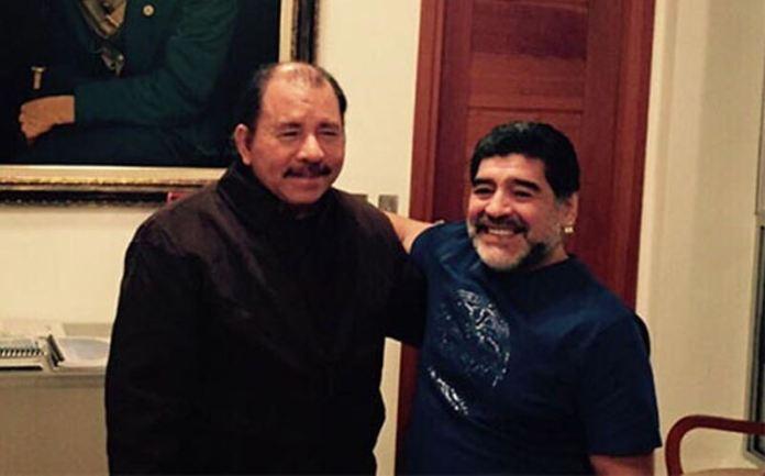 Former soccer star Diego Maradona (right) chums it up with President Daniel Ortega last week.