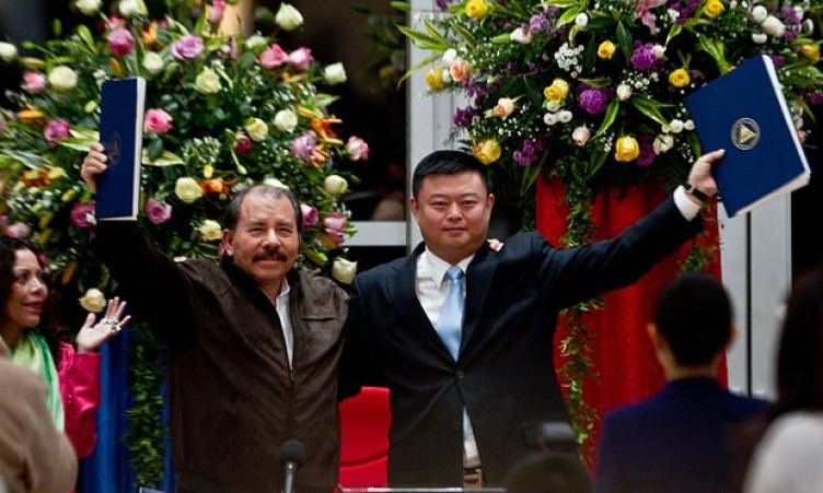Wang Jing (right) of HKND pictured with Nicaraguan president Daniel Ortega and the agreements for the construction of the interoceanic canal in 2013. HKND has invested more than 3bn yuan in the project. Photograph: Esteban Felix/AP