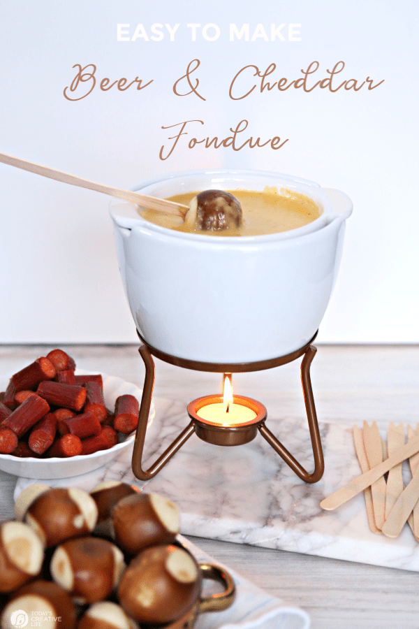 Cheese fondue pot with pretzel bites