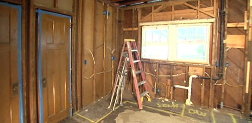 Gutted room during renovation.