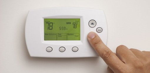 Adjusting a programmable thermostat.
