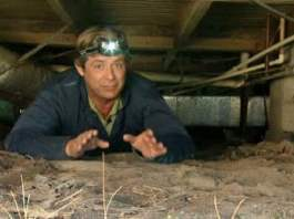 Allen Lyle in crawlspace under house.