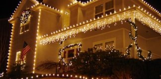 House covered in Christmas lights.