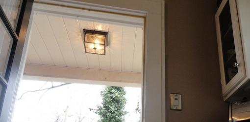 Timer switch on wall next to porch light