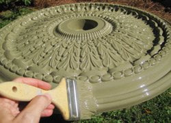 Painting a ceiling medallion with a chip brush