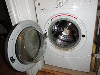 Washer door left open to allow tub to dry
