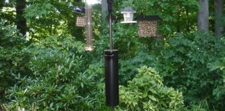 Homemade bird feeder baffle on pole