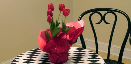 Tulips blooming indoors in pot.