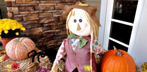 Fall porch display with scarecrow