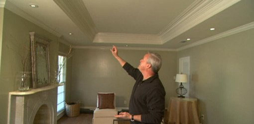 Danny Lipford examines a recessed ceiling.