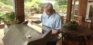 Danny Lipford with grill in backyard