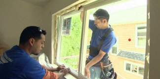 Window installers replacing windows on a home