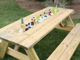 Completed picnic table drink trough full of drinks.
