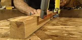 Jig for cutting bolts to length without damaging the threads.
