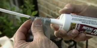 Making a flexible caulking tube nozzle extension with a straw and duct tape.