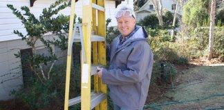 Danny Lipford preparing to power wash house.