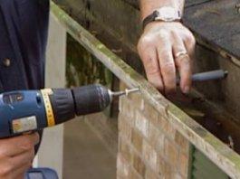 Installing gutter screws.
