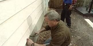 Danny Lipford replacing hardboard siding with fiber cement.