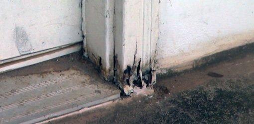 Rotten door casing and jamb.
