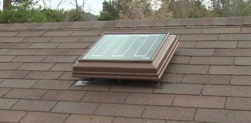 Solar powered attic ventilator mounted on roof.