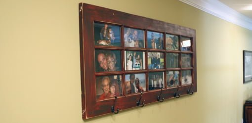 French door photo gallery and coat rack mounted on wall.