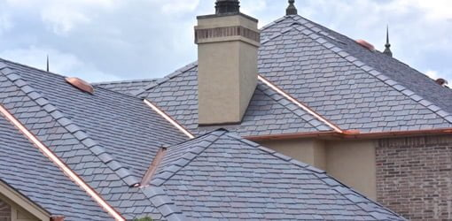Roof with polymer slate tile roofing.