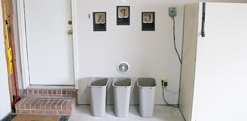 These chutes carry recycling from the laundry room into recycle bins in the garage.