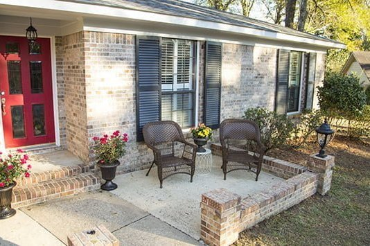 front porch with chairs and plants