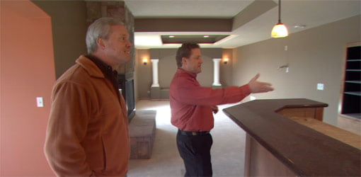 Danny Lipford with Matt Cook in remodeled basement.