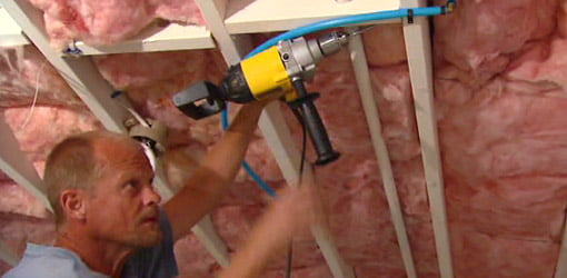 Drilling holes in ceiling joists to run wire for light