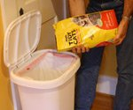 Adding kitty litter to kitchen garbage can to control odors.