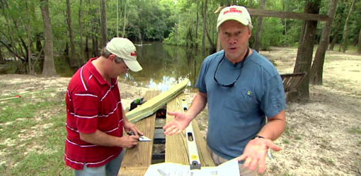 Allen Lyle and Danny Lipford tackle outside a river cabin.